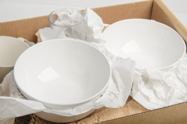 Dishes wrapped up in a box