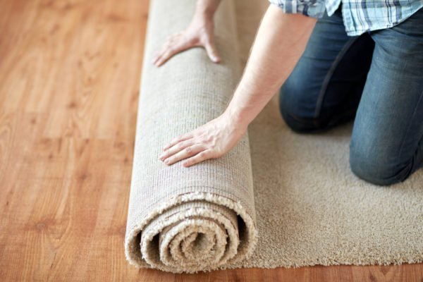 Rolling up a rug for storage