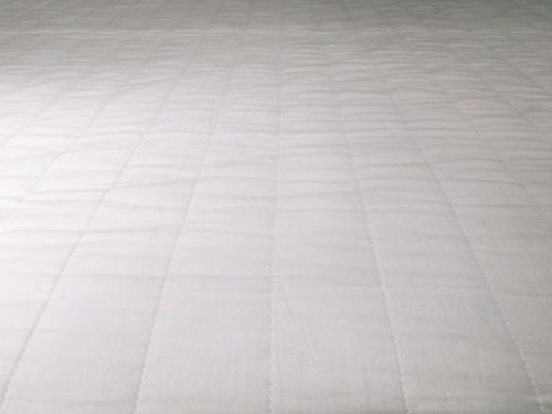 Close up of a white mattress