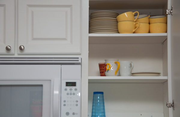 An organized kitchen cupboard