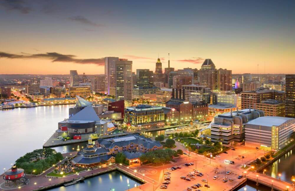 Skyline view of the inner harbor in Baltimore, Maryland at dusk.