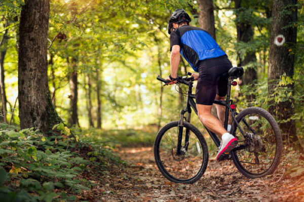 A man goes for an energizing ride on a DC bike trail.
