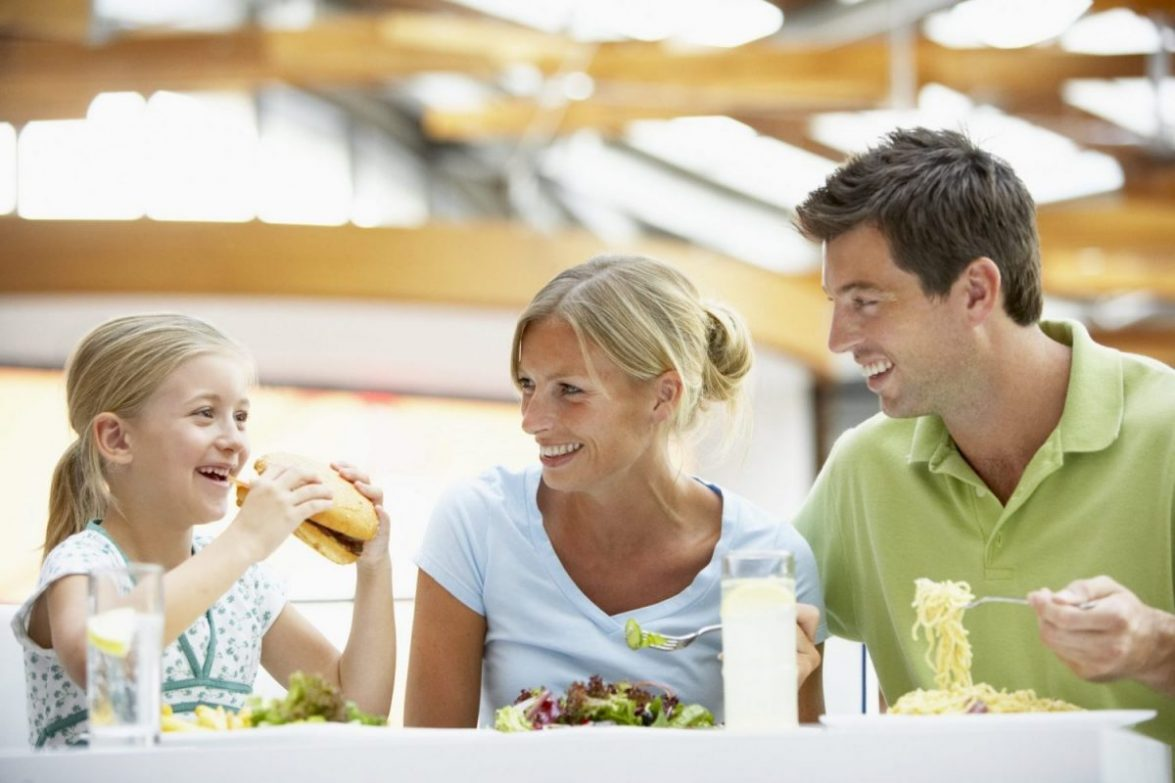 A family of three eat at a restaurant in Baltimore.