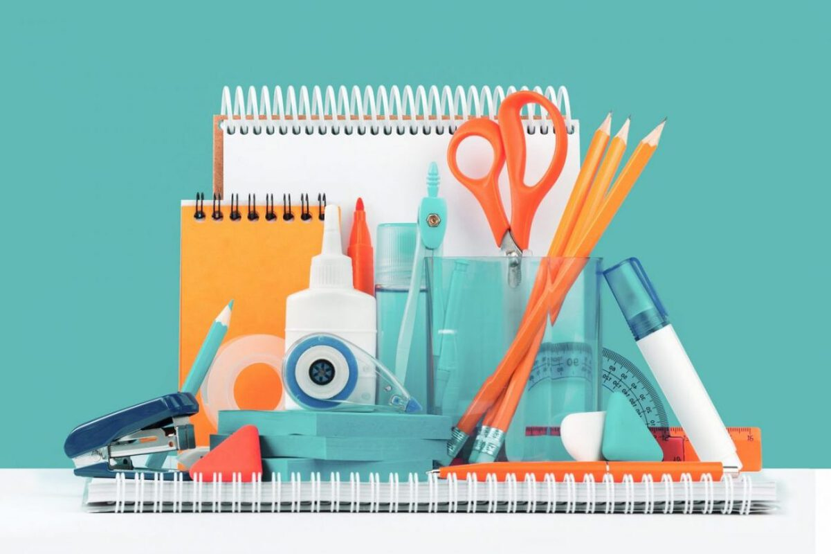 A set up of neatly organized school supplies.