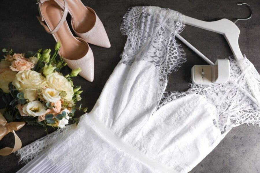 A wedding dress, shoes and bouquet ready for long term storage.